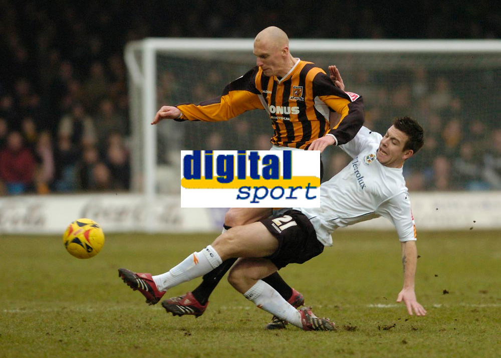 Photo: Leigh Quinnell.<br /> Luton Town v Hull City. Coca Cola Championship. 04/02/2006. Lutons Keith Keane tackles Hulls Kevin Ellison.