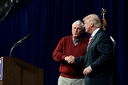 Republican presidential nominee Donald Trump is welcomed on stage by Retired basketball coach Robert Knight  at a rally in Aston, Pennsylvania.