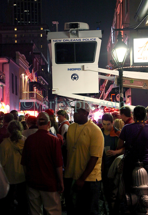 09 January 2012. New Orleans, Louisiana, USA.  <br /> BCS Championship. The Crimson Tide rolls over LSU as Alabama trounces LSU 21-0 to take the Championship for the second year in a row. Students and fans pored onto Bourbon Street as the partying carried on late into the night. Alabama fans celebrated as LSU fans commiserated. NOPD kept a watchful eye in the sky monitoring the crowds for potential trouble.<br /> Photos; Charlie Varley