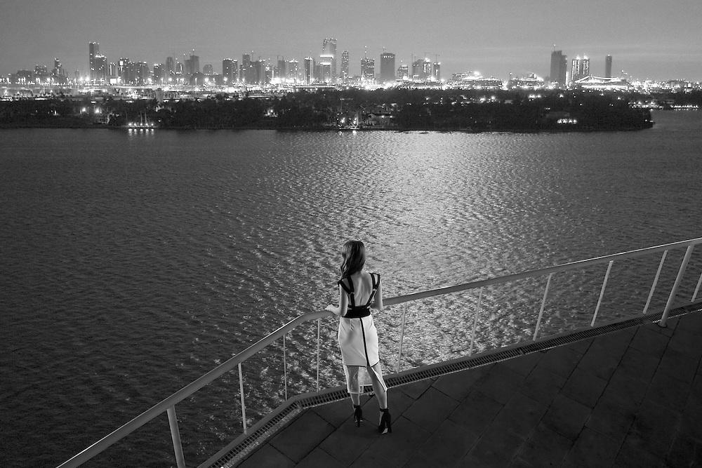 Stylish model in urban setting at night.