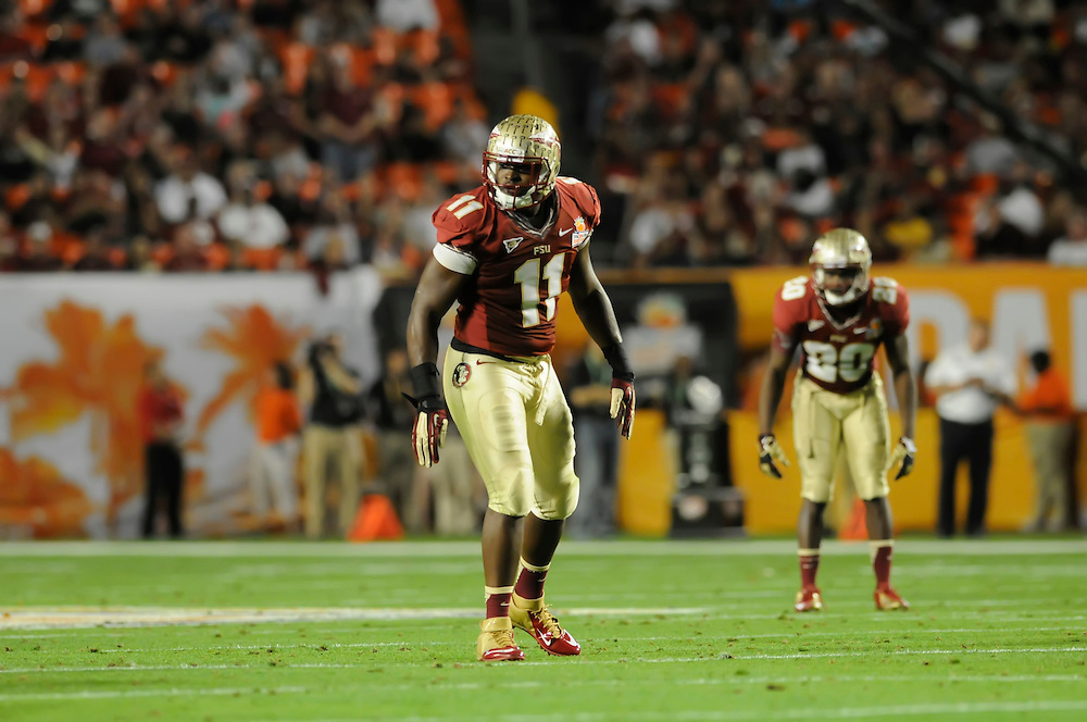 January 1, 2013: Vince Williams #11 of Florida State in action during the NCAA football game between the Northern Illinois Huskies and the Florida State Seminoles at the 2013 Orange Bowl in Miami Gardens, Florida. The Seminoles defeated the Huskies 31-10.