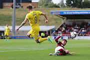 Northampton Town defender Aaron Phillips (18) tackles AFC Wimbledon midfielder Jake Reeves (8) during the EFL Sky Bet League 1 match between Northampton Town and AFC Wimbledon at Sixfields Stadium, Northampton, England on 20 August 2016. Photo by Stuart Butcher.