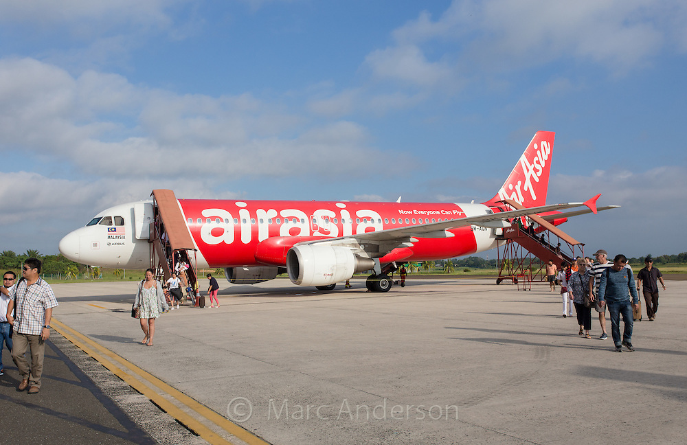 Passengers disembarking from Air Asia Airbus A320 on the tarmac at Kuala Lumpur International Airport 2 (KLIA2). Aircraft registration number 9M AQN