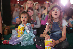 Two children watching Frozen in the Pilton Palais cinema tent on Day 1 of the 2017 Glastonbury Festival at Worthy Farm in Somerset. Photo date: Thursday, June 22, 2017. Photo credit should read: Richard Gray/EMPICS Entertainment
