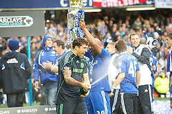 LONDON, ENGLAND - Sunday, May 9, 2010: Chelsea's Hilario opens the champagne as Chelsea win the 2009/10 Premier League Trophy during the final Premiership match of the season at Stamford Bridge. (Pic by Gareth Davies/Propaganda)