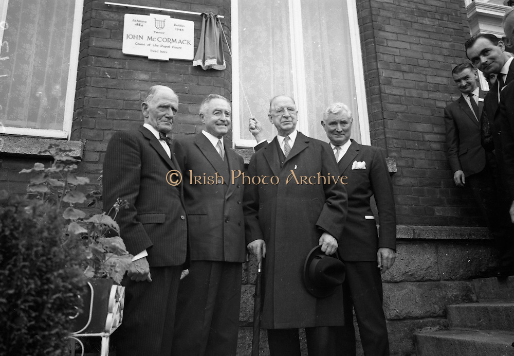 """The American Ambassador to  Ireland, Raymond R. Guest, unveilled a plaque at """"Glena"""", Rock Road, Booterstown, Co. Dublin, the house in which John Count McCormack, the world famous Irish tenor, died 21 years ago. Pictured at the ceremony are Dr. John F. Larchet, President of the John McCormack Society of Ireland; Cyril Count McCormack, son of the late John McCormack; President Eamon de Valera; and the American Ambassador Raymond R. Guest..27.09.1966"""