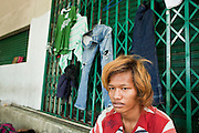 Sept. 23, 2009 -- BANGKOK, THAILAND: A homeless teenager who lives at the foot of Memorial Bridge in Bangkok with his clothes. The homeless camp has been there for about 20 years. Most of the people who live there are children and teenagers ages 10 - 20. Photo by Jack Kurtz / ZUMA Press