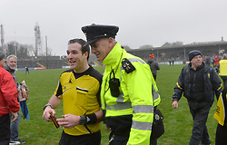 Referee Martin McNally is escorted off the pitch after the intermediate semi-final between Westport and Kenmare Shamrocks in Ennis.<br />
