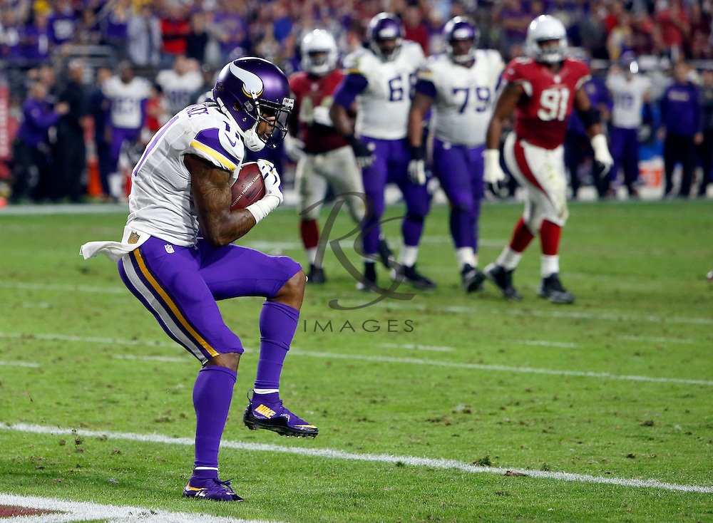 Minnesota Vikings wide receiver Mike Wallace (11) pulls in a touchdown catch against the Arizona Cardinals during the second half of an NFL football game, Thursday, Dec. 10, 2015, in Glendale, Ariz. (AP Photo/Rick Scuteri)
