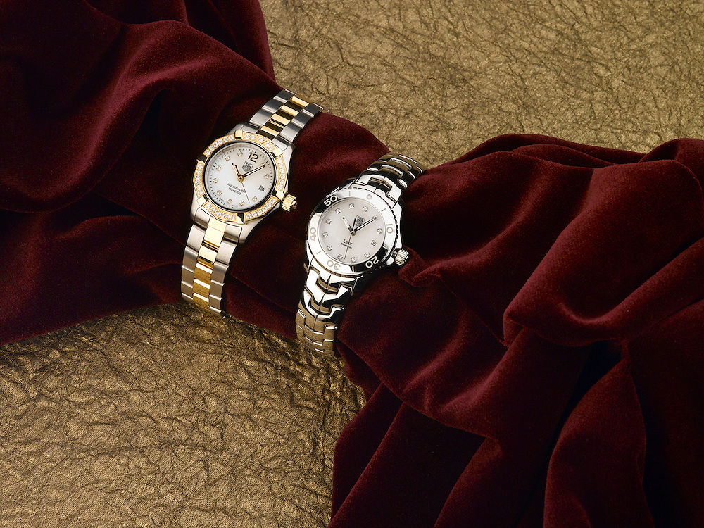Tag Heuer watches on red velvet