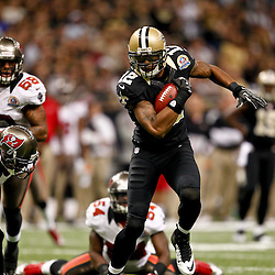 December 16, 2012; New Orleans, LA, USA; New Orleans Saints wide receiver Marques Colston (12) escapes from Tampa Bay Buccaneers free safety Ronde Barber (20) and outside linebacker Lavonte David (54) during the first quarter of a game at the Mercedes-Benz Superdome. The Saints defeated the Buccaneers 41-0. Mandatory Credit: Derick E. Hingle-USA TODAY Sports