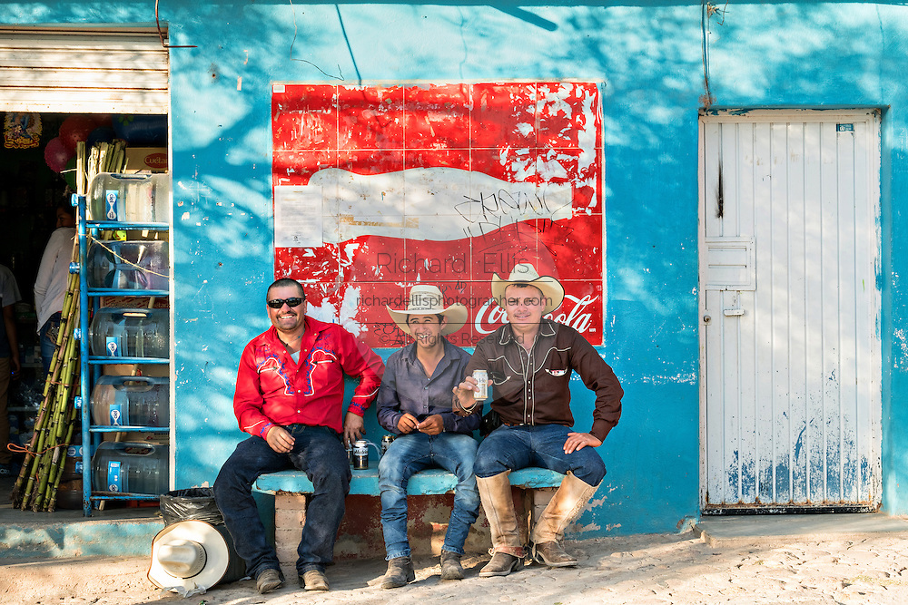 Mexican cowboys take a break for a cold beer after arriving to camp at a village stop along the road during the annual Cabalgata de Cristo Rey pilgrimage January 4, 2017 in La Sauceda, Guanajuato, Mexico. Thousands of Mexican cowboys and horse take part in the three-day ride to the mountaintop shrine of Cristo Rey stopping along the way at shrines and churches.