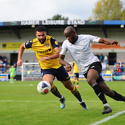 TELFORD COPYRIGHT MIKE SHERIDAN Theo Streete of Telford heads past Hamza Bencherif during the Vanarama National League Conference North fixture between AFC Telford United and Guiseley on Saturday, October 19, 2019.<br /> <br /> Picture credit: Mike Sheridan/Ultrapress<br /> <br /> MS201920-026