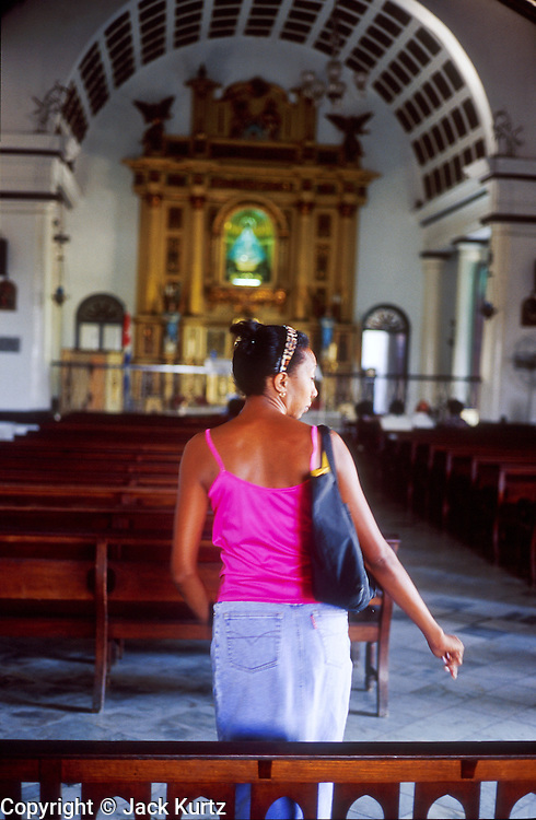 25 JULY 2002 - HAVANA, HAVANA, CUBA: A woman in a Catholic church in the Regla section of Havana, Cuba, July 25, 2002..PHOTO BY JACK KURTZ