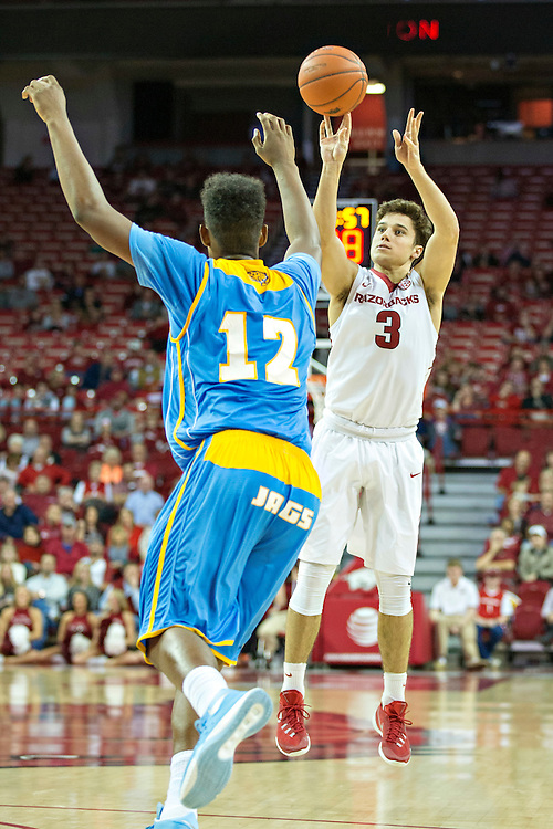 FAYETTEVILLE, AR - NOVEMBER 13:  Dusty Hannahs #3 of the Arkansas Razorbacks goes up for a shot over Jarred Sam #12 of the Southern University Jaguars at Bud Walton Arena on November 13, 2015 in Fayetteville, Arkansas.  The Razorbacks defeated the Jaguars 86-68.  (Photo by Wesley Hitt/Getty Images) *** Local Caption *** Dusty Hannahs; Jarred Sam
