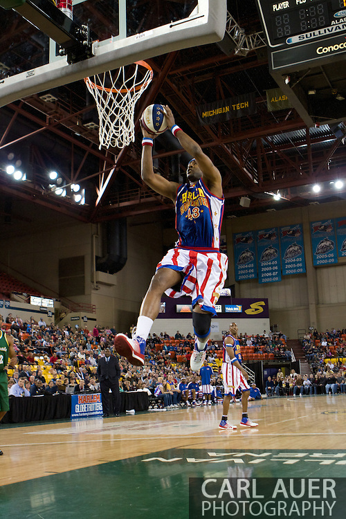 April 30th, 2010 - Anchorage, Alaska:  Harlem Globetrotter Hawk (43) flies to the hoop for a two handed jam.
