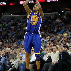 January 5, 2011; New Orleans, LA, USA; Golden State Warriors shooting guard Monta Ellis (8) shoots against the New Orleans Hornets during the second half at the New Orleans Arena. The Warriors defeated the Hornets 110-103.  Mandatory Credit: Derick E. Hingle