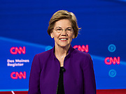 "14 JANUARY 2020 - DES MOINES, IOWA: Senator ELIZABETH WARREN on stage during the ""photo spray"" at the CNN Democratic Presidential Debate on the campus of Drake University in Des Moines. This is the last debate before the Iowa Caucuses on Feb. 3.    PHOTO BY JACK KURTZ"