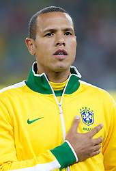 Luis Fabiano of Brazil singing national anthem during the 2010 FIFA World Cup South Africa Group G Second Round match between Brazil and République de Côte d'Ivoire on June 20, 2010 at Soccer City Stadium in Soweto, suburban Johannesburg, South Africa.  Brazil defeated Ivory Coast 3-1. (Photo by Vid Ponikvar / Sportida)