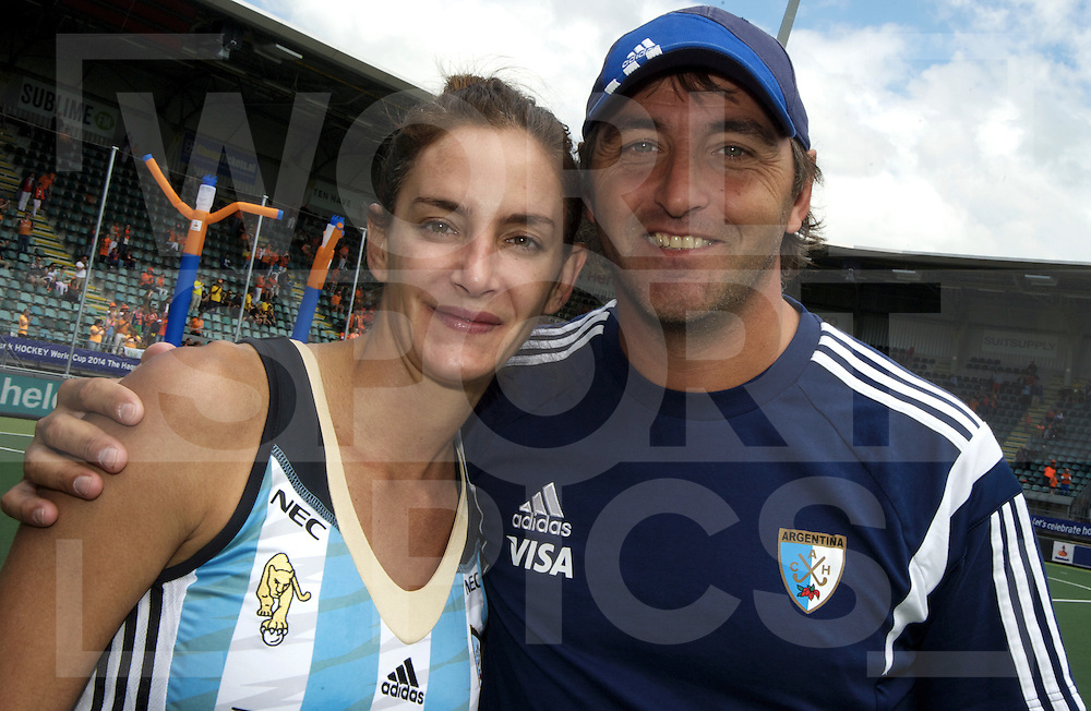 DEN HAAG - Rabobank Hockey World Cup<br /> 37 3rd Place match: Argentina - USA<br /> Foto: Luciana Aymar (left) and Carlos Retegui.<br /> COPYRIGHT FRANK UIJLENBROEK FFU PRESS AGENCY