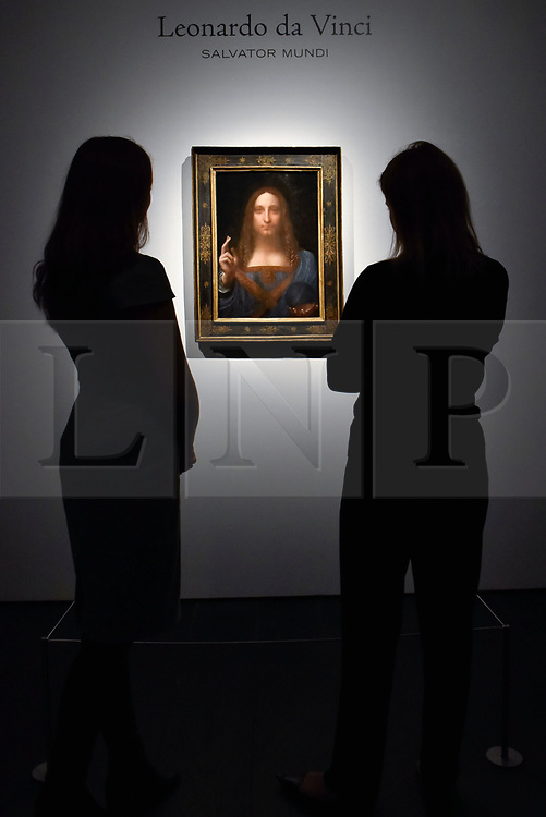 """FILE PICTURE © Licensed to London News Pictures. 24/10/2017. LONDON, UK.  Staff members view """"Salvator Mundi"""", c1500, by Leonardo da Vinci at a photocall at Christie's in London.  The artwork is the last Da Vinci painting in private hands and was offered for sale by Christie's in New York on 15 November with an estimate in the region of US$100m, but eventually sold for $450m including buyer's premium.  Photo credit: Stephen Chung/LNP"""