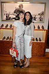 Left to right, MARIA CASTANI and ZEINA DAKAK at a party to celebrate the 10th anniversary of Gaziano & Girling's at 39 Savile Row, London on 14th September 2016.