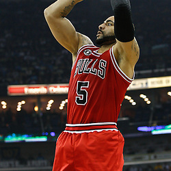 February 12, 2011; New Orleans, LA, USA; Chicago Bulls power forward Carlos Boozer (5) shoots against the New Orleans Hornets during the first quarter at the New Orleans Arena.   Mandatory Credit: Derick E. Hingle