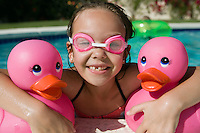 Girl at Pool Side Holding Pink Rubber Ducks