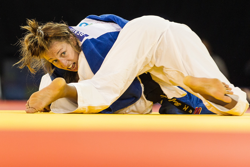 Catherine Beauchemin-Pinard pins Rafaela Silva of Brazil  in their final of the table in the 57kg class at the 2015 Pan American Games in Toronto, Canada, July 12,  2015. Beauchemin-Pinard  held on to win sending her to Sunday night's gold medal contest.  AFP PHOTO/GEOFF ROBINS