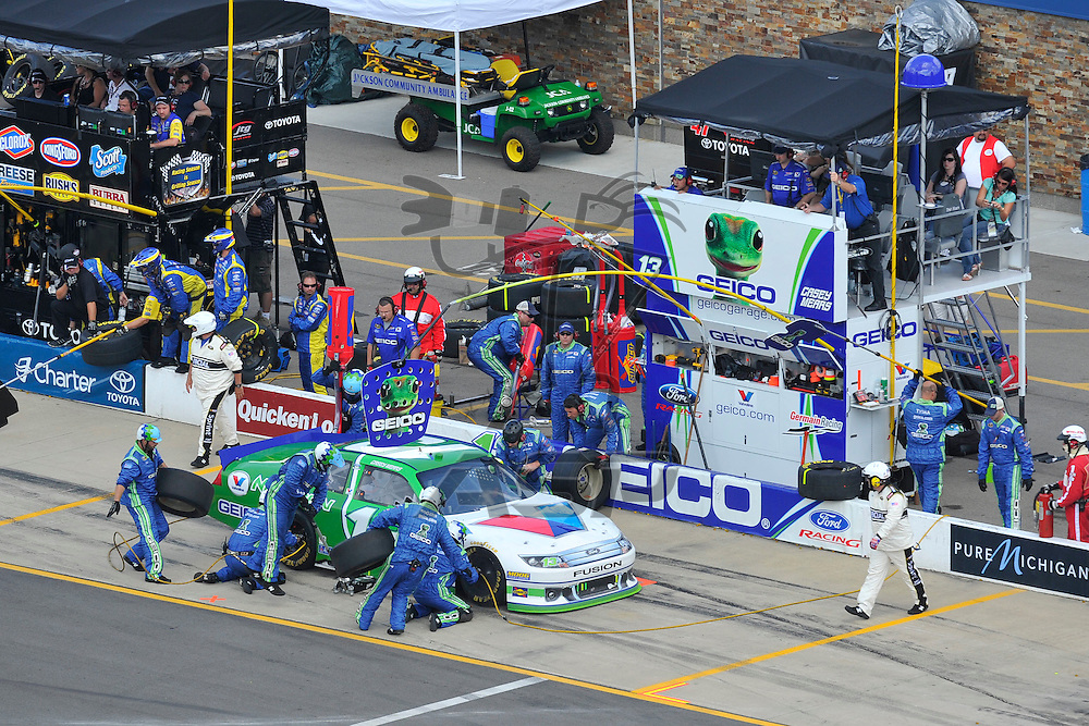 Brooklyn, MI - JUN 17, 2012: Casey Mears (13) makes a pit stop during race action for the Quicken Loans 400 race at the Michigan International Speedway in Brooklyn, MI.