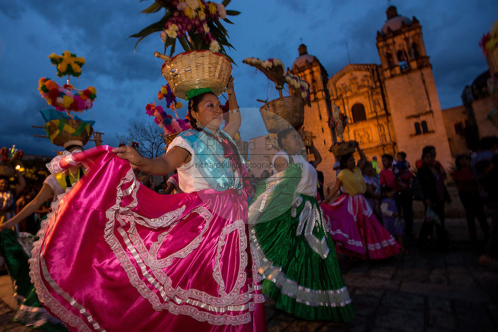 Young women dressed in traditional costumes parade in a comparsas past the Santo Domingo de Guzmán Church during the Day of the Dead Festival known in Spanish as Día de Muertos on November 2, 2013 in Oaxaca, Mexico.