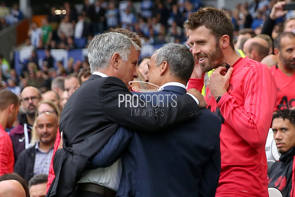 Brighton and Hove Albion manager Chris Hughton greets Manchester United Manager Jose Mourinho with Michael Carrick during the Premier League match between Brighton and Hove Albion and Manchester United at the American Express Community Stadium, Brighton and Hove, England on 19 August 2018.