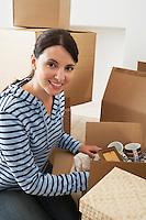 Woman Unpacking Moving Box