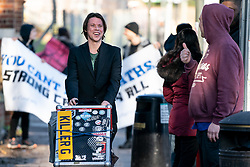 © Licensed to London News Pictures. 11/02/2019. London, UK. Lauri Love (L) arrives at Hendon Magistrates' Court. Love, an alleged hacker, is using the 'Police (Property) Act of 1897' to seek the return of his computers which were seized by police over five years ago. Last year, The High Court blocked Love's extradition to the United States. Photo credit : Tom Nicholson/LNP
