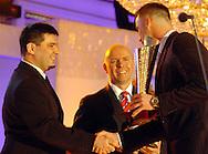 n/z.: Adam Godlewski ( dziennikarz - media ) , Artur Boruc - odkrycie roku , Gala Tygodnika Pilka Nozna , hotel Marriott ,  sezon 2004/2005 , pilka nozna , Polska , Warszawa , 18-12-2004 , fot.: Adam Nurkiewicz / mediasport.pl..Adam Godlewski ( journalist - media ) , Artur Boruc - best new player during 2004 Best Player's ceremony of Weekly Pilka Nozna at Marriott Hotel in Warsaw. December 18, 2004 ; season 2004/2005 , football , soccer , Poland , Warsaw ( Photo by Adam Nurkiewicz / mediasport.pl )