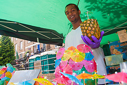 London, August 24th 2014. A vendor offers rum punch as revellers prepare to participate in 2014's Notting Hill Carnival in London, celebratingWest Indian and other cultures, and attracting hundreds of thousands to Europe's biggest street party.