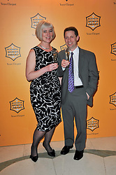 Winner of the 38th Veuve Clicquot Business Woman Award MICHELLE McDOWELL and her partner JASON FOX at the 38th Veuve Clicquot Business Woman Award held at Claridge's, Brook Street, London W1 on 28th March 2011.