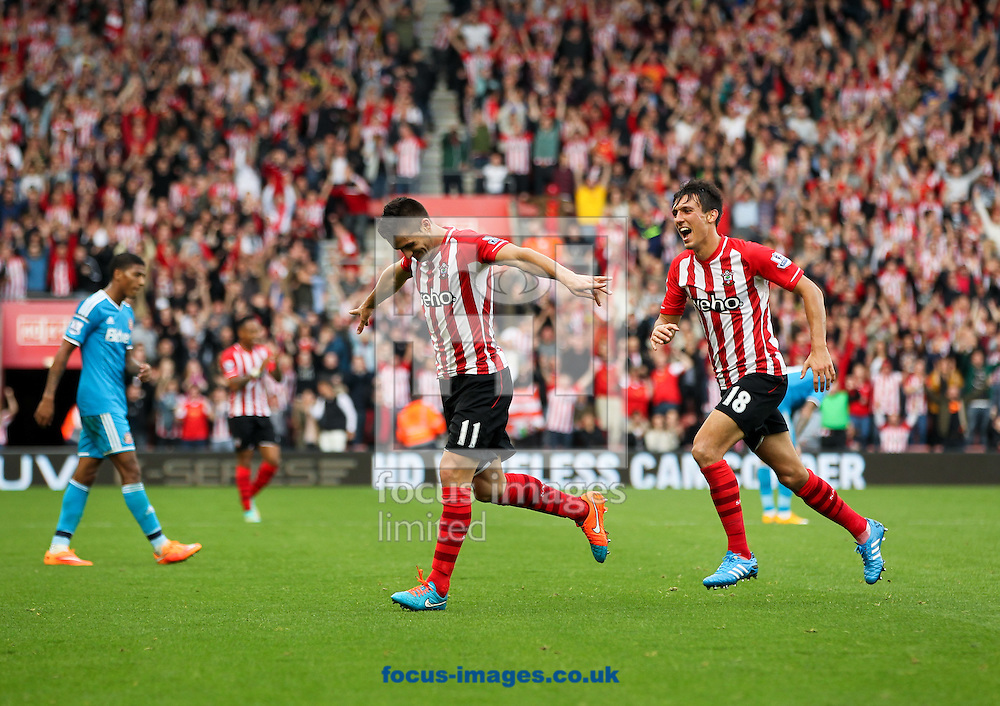 Du&scaron;an Tadić (centre) of Southampton celebrates scoring his sides sixth goal followed by his team mate Jack Cork (right) during the Barclays Premier League match at the St Mary's Stadium, Southampton<br /> Picture by Tom Smith/Focus Images Ltd 07545141164<br /> 18/10/2014