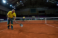 Court staff repair and prepare clay court four days before the BNP Paribas Davis Cup 2013 between Poland and Australia at Torwar Hall in Warsaw on September 09, 2013.<br /> <br /> Poland, Warsaw, September 09, 2013<br /> <br /> Picture also available in RAW (NEF) or TIFF format on special request.<br /> <br /> For editorial use only. Any commercial or promotional use requires permission.<br /> <br /> Photo by © Adam Nurkiewicz / Mediasport