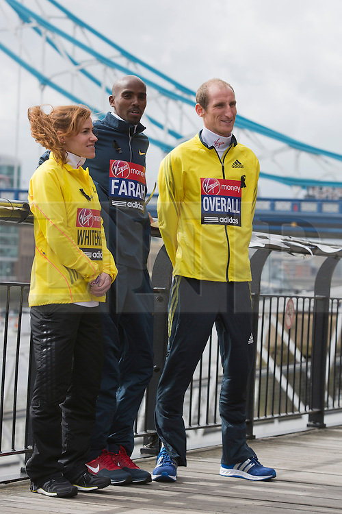 © Licensed to London News Pictures. 18/04/2013. London, England. L-R: Amy Whitehead, Mo Farah and Steve Overall. Virgin London Marathon - Photocall with British Marathon Runners Athletes Scott Overall, Amy Whitehead and Mo Farah at Tower Bridge, London, ahead of Sunday's race. Photo credit: Bettina Strenske/LNP