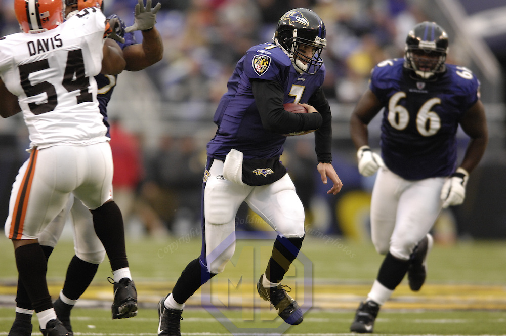18 November 2007:  Baltimore Ravens quarterback Kyle Boller (7) runs up the middle for a 15-yard gain in the the 4th quarter before being brought down by Cleveland Browns defensive end Simon Fraser (75) on November 18, 2007 at M&T Bank Stadium in Baltimore, Maryland. The Ravens were sent to their 4th consecutive loss with a 33-30 overtime time win by the Browns..