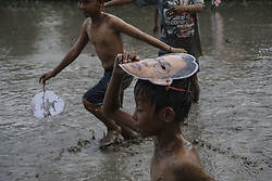 August 6, 2017 - Sleman, Yogyakarta, Indonesia - Indonesian boys  wears Indonesian corruptor mask compete for a ball as their playing mud soccer during the 72th Indonesia National Independence day celebration in Yogyakarta, Indonesia on August 6, 2017. Indonesian Independence day is commemorated every August 17th. (Credit Image: © Nugroho Hadi Santoso/NurPhoto via ZUMA Press)