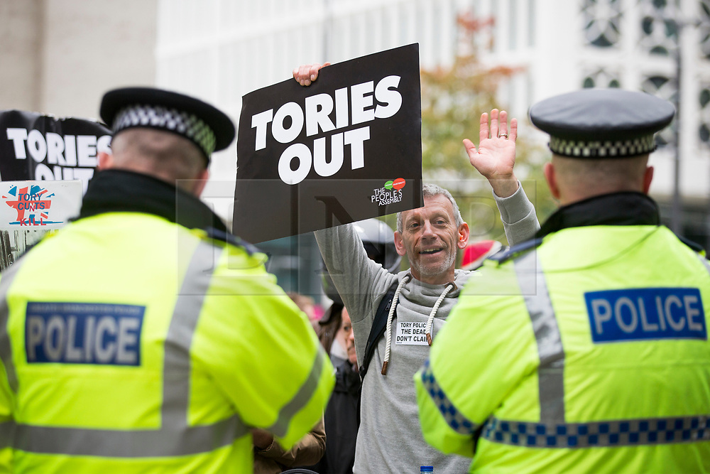 © Licensed to London News Pictures. 04/10/2017. Manchester UK. Anti Tory protests are taking place outside the Midland hotel in Manchester on the third & final day of the Conservative Party Conference today in Manchester. Photo credit: Andrew McCaren/LNP