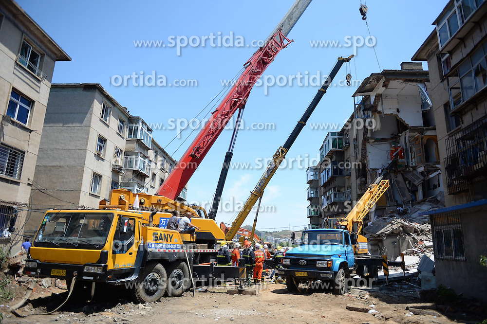 Rescuers work at the accident scene where an explosion took place in Huludao City, northeast China's Liaoning Province, June 12, 2015. One person died and two others are missing after an explosion ripped through a residential building on Friday morning in Huludao. Nine residents have been rescued from the rubble and a dozen injured, including three pedestrians, have been hospitalized. The explosion was suspected to be caused by liquified gas leak. EXPA Pictures &copy; 2015, PhotoCredit: EXPA/ Photoshot/ Pan Yulong<br /> <br /> *****ATTENTION - for AUT, SLO, CRO, SRB, BIH, MAZ only*****
