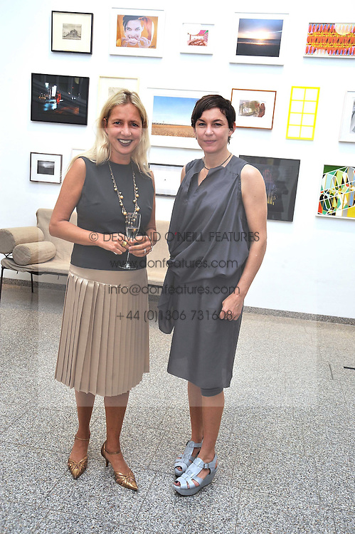 Left to right, IWONA BLAZWICK Director of the gallery and artist ELIZABETH PEYTON at a private view of work by artist Elizabeth Peyton 'Live Forever' held at the Whitechapel Gallery, 77-82 Whitechapel High Street, London E1 on 7th July 2009.