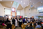 Congregants welcome new members during service at Zion Baptist Church in Madison, Wisconsin, Sunday, Feb. 4, 2018.