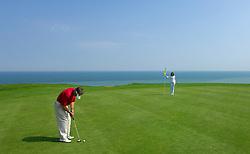 NORMANDY, FRANCE - MAY-01-2007 - Omaha Beach Golf Club - Course: La Mer (The Sea) - Hole 6 - 469 yards - Par 4...Lionel Caron of Meudon, France.and Alexandra Boleslawski, of Paris, France enjoy a day on the links at the Omaha Beach Golf Club. (Photo © Jock Fistick)