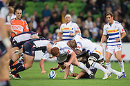 Steven Kitshoff (Stormers) and Siyamthanda Kolisi (Stormers) attempt to take possession of the ball after Scott Fuglistaller (Rebels) releases it after being tackled during the Round 14 match of the 2013 Super Rugby Championship between RaboDirect Rebels vs DHL Stormers at AAMI Park, Melbourne, Victoria, Australia. 17/05/0213. Photo By Lucas Wroe