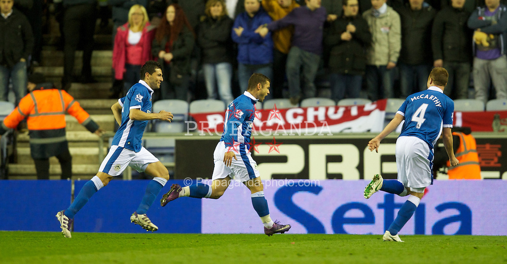 WIGAN, ENGLAND - Wednesday, April 11, 2012: Wigan Athletic's Shaun Maloney celebrates scoring the first goal against Manchester United during the Premiership match at the DW Stadium. (Pic by David Rawcliffe/Propaganda)