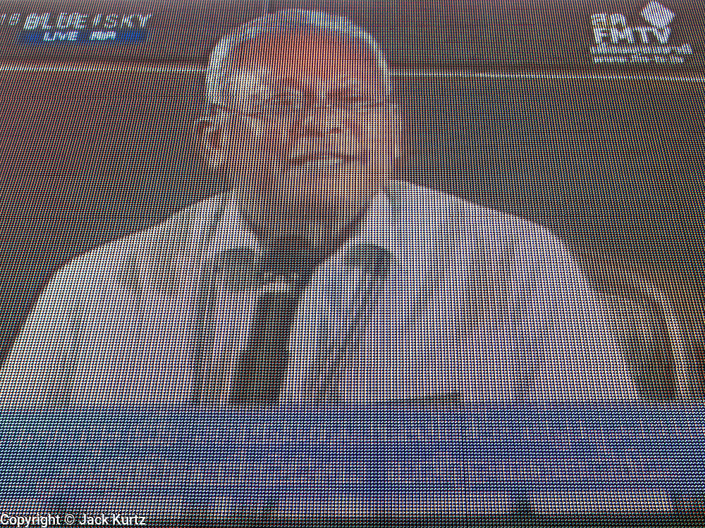 14 DECEMBER 2013 - BANGKOK, THAILAND:  SUTEHEP THAUGSUBAN, as seen on a large television screen at an anti-government rally in Bangkok. Suthep spoke to his supports long distance from one of several anti-government forums held in Bangkok Saturday. The Thai anti-government movement, called the People's Democratic Reform Committee (PRDC) sponsored a forum Saturday to establish guidelines for political reform in Thailand. The opposition leader, Suther Thaugsuban, said his movement will not participate in a similar forum, sponsored by the government scheduled for Sunday. Thailand's political impasse continues with the opposition calling for the caretaker government of Prime Minister Yingluck Shinawatra to step down. Yingluck has, so far, refused to step down from her caretaker roll. Crowds at the anti-government rallies have shrunk substantially since the collapse of the government earlier in the week.       PHOTO BY JACK KURTZ